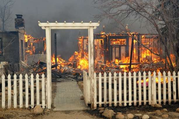 home burns, white picket fence remains