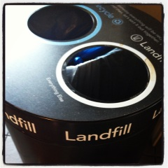 trash can labeled landfill