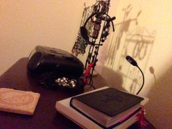 nightstand with radio and books